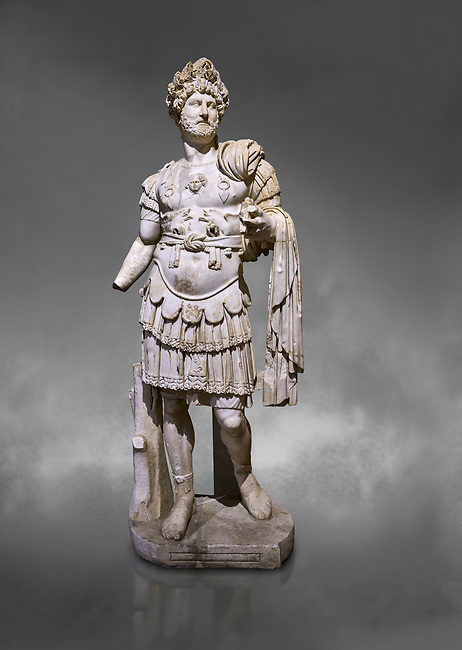 Roman statue of Emperor Hadrian. Marble. Perge. 2nd century AD. Inv no 3730-3728. Antalya Archaeology Museum; Turkey. Against a grey background