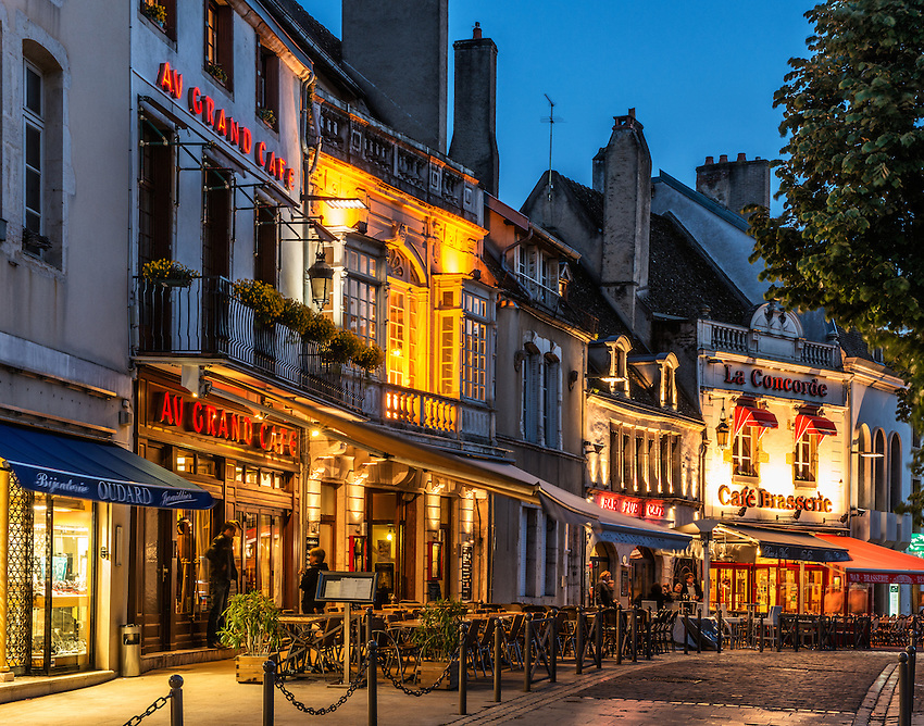 "A string of cafes light up the Place Carnot in the evening in spring, during the ""blue hour,"" in Beaune, Burgundy, France."