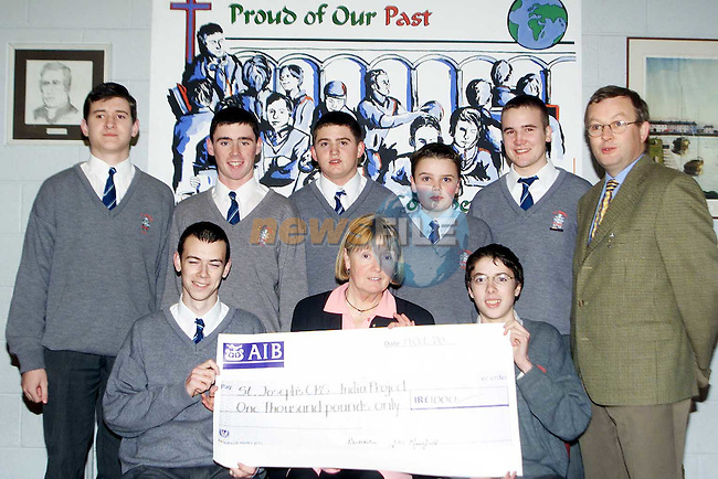 Pupils from St. Joseph's CBS who helped raise £1,000 through thier 'Copper Collection' for students who are going to India. Pictured are Back L/R, Anthony Reilly, Mark cassidy, Barry McGahy, James McNicholas, Richard Maher and teacher John Mansfield. Front Row, Thomas Nutley, teacher Marie McCabe and Simon Thornton..Picture: Paul Mohan/Newsfile