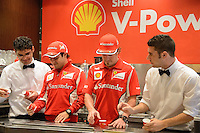 MELBOURNE, 15 March - Fernando Alonso and Felipe Massa join Ferrari fans for coffee at Brunetti cafe in Carlton ahead of the the 2012 Formula One Australian Grand Prix at the Albert Park Circuit in Melbourne, Australia. (Photo Sydney Low / syd-low.com)
