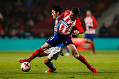 9th January 2018, Wanda Metropolitano, Madrid, Spain; Copa del Rey football, round of 16, second leg, Atletico Madrid versus Lleida;  Kevin Gameiro (Atletico de Madrid) and Cheng (Lleida) fight for control of the ball