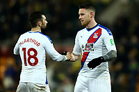 1st January 2020; Carrow Road, Norwich, Norfolk, England, English Premier League Football, Norwich versus Crystal Palace; Connor Wickham of Crystal Palace celebrates the 1-1 draw with James McArthur - Strictly Editorial Use Only. No use with unauthorized audio, video, data, fixture lists, club/league logos or 'live' services. Online in-match use limited to 120 images, no video emulation. No use in betting, games or single club/league/player publications