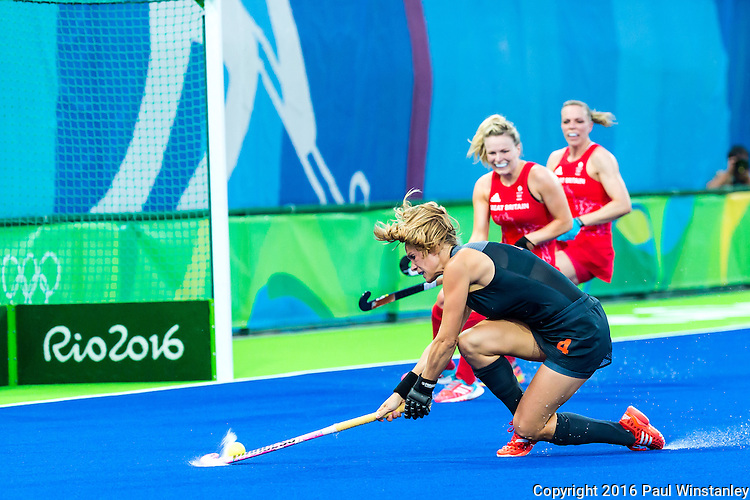 Kitty van Male #4 of Netherlands takes the reverse stick shot during Netherlands vs Great Britain in the gold medal final at the Rio 2016 Olympics at the Olympic Hockey Centre in Rio de Janeiro, Brazil.