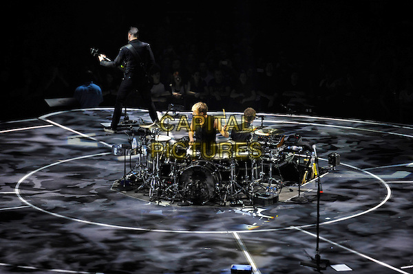 LONDON, ENGLAND - APRIL 3: Dominic Howard and Chris Wolstenholme of 'Muse' performing at the O2 Arena on April 3, 2016 in London, England.<br /> * Press use only. No merchandising *<br /> CAP/MAR<br /> &copy;MAR/Capital Pictures