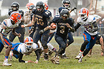 ANSONIA, CT. 02 December 2018-120218 - Ansonia running back Shykeem Harmon #3 runs with ball up the middle past the diving Bloomfield's Antwan Tinsley #18 and Bloomfield's Jaden Saulter #55, right, during the Class S Semi-final game between Bloomfield and Ansonia at Ansonia High School in Ansonia on Sunday. Bloomfield held on to beat Ansonia 26-19 and advances to the Class S Championship game next week. Bill Shettle Republican-American