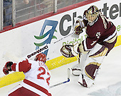 Cory Schneider 1 of Boston College and Ben Street 22 of the University of Wisconsin head for the puck behind the Boston College net. The Boston College Eagles defeated the University of Wisconsin Badgers 3-0 on Friday, October 27, 2006, at the Kohl Center in Madison, Wisconsin in their first meeting since the 2006 Frozen Four Final which Wisconsin won 2-1 to take the national championship.<br />