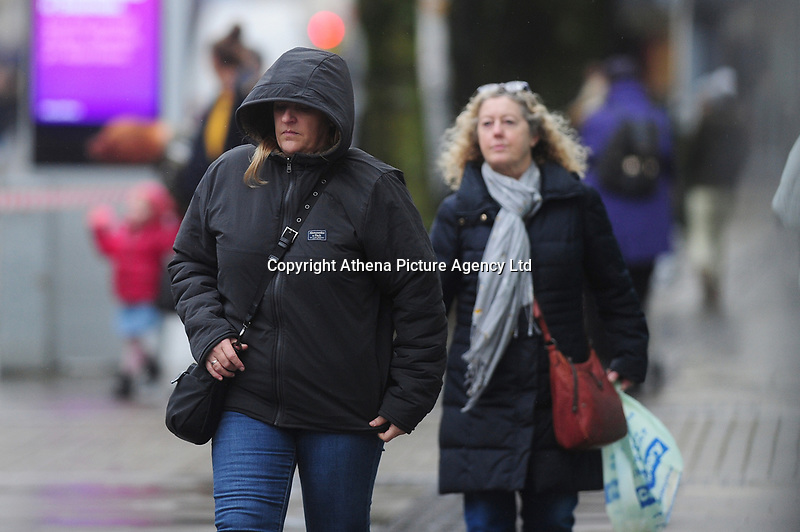 Pictured: A lady walks as she battle with the wind and rain in Swansea City Centre, Swansea Wales, UK. Friday 08 February 2019<br /> Re: