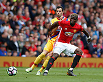 Luka Milivojevic of Crystal Palace in action with Paul Pogba of Manchester United during the English Premier League match at the Old Trafford Stadium, Manchester. Picture date: May 21st 2017. Pic credit should read: Simon Bellis/Sportimage