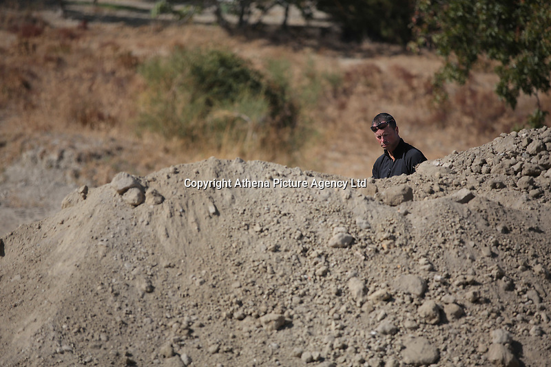 Pictured: A forensic archaeologist searches through dirt at the second site in Kos, Greece. Sunday 16 October 2016<br /> <br /> Re: Police teams led by South Yorkshire Police are searching for missing toddler Ben Needham on the Greek island of Kos.<br /> Ben, from Sheffield, was 21 months old when he disappeared on 24 July 1991 during a family holiday.<br /> Digging has begun at a new site after a fresh line of inquiry suggested he could have been crushed by a digger.