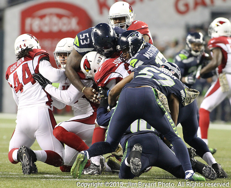 Seattle Seahawks  kickoff coverage team members K.J. Wright (50), Nick Moody (53), Chris Mathews(13) and Mike Morgan (57) stop Arizona Cardinals return specialists David Johnson (31) at CenturyLink Field in Seattle, Washington on November 15, 2015. The Cardinals beat the Seahawks 39-32.   ©2015. Jim Bryant photo. All Rights Reserved.