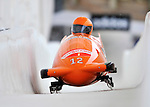 16 December 2010:  Esme Kamphuis of the Netherlands pilots a 2-man bobsled in a training run prior to the Viessmann FIBT World Cup Championships in Lake Placid, New York, USA. Mandatory Credit: Ed Wolfstein Photo
