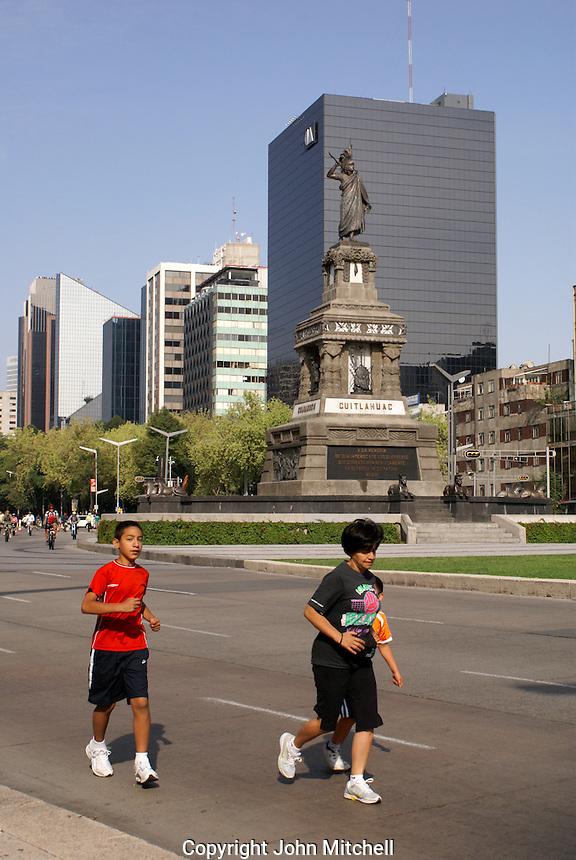 Joggers on Paseo de la Reforma in Mexico City