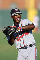 Shortstop Ozhaino Albies (7) of the Rome Braves warms up before a game against the Greenville Drive on Monday, June 15, 2015, at Fluor Field at the West End in Greenville, South Carolina. Greenville won, 9-3. (Tom Priddy/Four Seam Images)