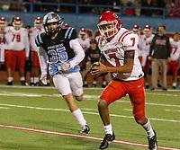 Northside quarterback Dreyden Norwood runs by Southside's Caleb Sanders during Friday's game at Fort Smith Southside.
