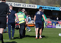 Jack Barthram of Cheltenham Town  is stretchered off during the Sky Bet League 2 match between Wycombe Wanderers and Cheltenham Town at Adams Park, High Wycombe, England on the 8th April 2017. Photo by Liam McAvoy.