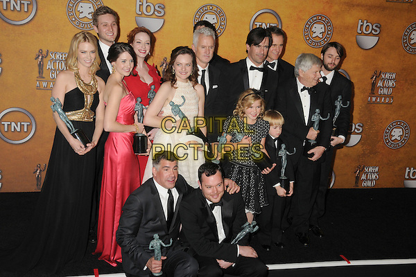 "The cast and creators of ""Mad Men"".15th Annual Screen Actors Guild Awards held at the Shrine Auditorium, Los Angeles, California, USA..January 25th, 2009.SAG pressroom full length award trophies trophy black white suit dress red .CAP/ADM/BP.©Byron Purvis/AdMedia/Capital Pictures."