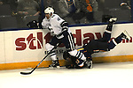 St. Louis Blues center Vladimir Sobotka (17) is upended by Vancouver Canucks center Maxim Lapierre (40) in first period action, which drew a foul on Lapierre during a game between the Vancouver Canucks and the St. Louis Blues on Tuesday April 16, 2013 at the Scottrade Center in downtown St. Louis.