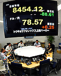June 1, 2012, Tokyo, Japan - An electric board flashes the current quote for stocks, above, and yen-dollar exchange rate during the morning session on the Tokyo foreign exchange market on Friday, June 1, 2012.The Japanese government on Friday stepped up its warning against investors apparently increasing short-term bets and adding to volatility in the currency market, indicating it would intervene to curb the yen's strength if necessary.(Photo by Natsuki Sakai/AFLO) AYF -mis-