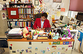 MR / Schenectady, NY.Yates Arts-in-Education Magnet School; urban school.Principal (African-American and Native American) writes at her desk in her child-friendly office..MR: Sco4.©Ellen B. Senisi