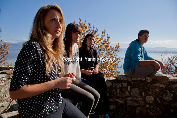 Greek students from left: Agathi Sideri,17, Ersi Kyrochristou,17, Dinos Athanasiou,18, and Andreas Nasios,18, relax from their lessons near by the Ioannina lake.