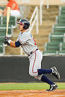 Chase Anselment #32 of the Rome Braves follows through on his swing against the Kannapolis Intimidators at CMC-Northeast Stadium on August 5, 2012 in Kannapolis, North Carolina.  The Intimidators defeated the Braves 9-1.  (Brian Westerholt/Four Seam Images)