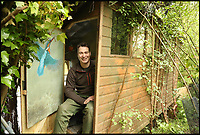 BNPS.co.uk (01202 558833)<br /> Pic: RobertFullerGallery/BNPS<br /> <br /> Robert Fuller in his hide.<br /> <br /> Watch the birdie!<br /> <br /> These incredible photographs give a rare insight into the secret underground world of kingfishers raising their young.<br /> <br /> Wildlife photographer Robert Fuller undertook his most ambitious project to date by creating a 16ft long artificial riverbank with a nest and a hide where he could watch the birds without disturbing them.<br /> <br /> It allowed him to get unique video footage of the elusive bird and he even witnessed eggs being laid.
