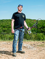 Dustin Harper (cq), with team Trashy Boyz from Searcy, Arkansas, at the U.S. Open Bowfishing Championship, Saturday, May 3, 2014. <br /> <br /> Photo by Matt Nager