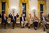 Senior administration officials listen as United States President Barack Obama delivers a statement in the East Room of the White House on the mission against Osama bin Laden, Sunday, May 1, 2011. Seated from left, James Clapper, Director of National Intelligence, National Security Advisor Tom Donilon, CIA Director Leon Panetta, Admiral Mike Mullen, Chairman of the Joint Chiefs of Staff, Secretary of State Hillary Rodham Clinton, and Vice President Joe Biden. .Mandatory Credit: Pete Souza - White House via CNP
