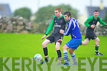 Fenit Samphires David O'Sullivan tries to get his pass away against Abbeyfeale's Mike Kelliher in the FAI Junior cup at Fenit on Saturday.