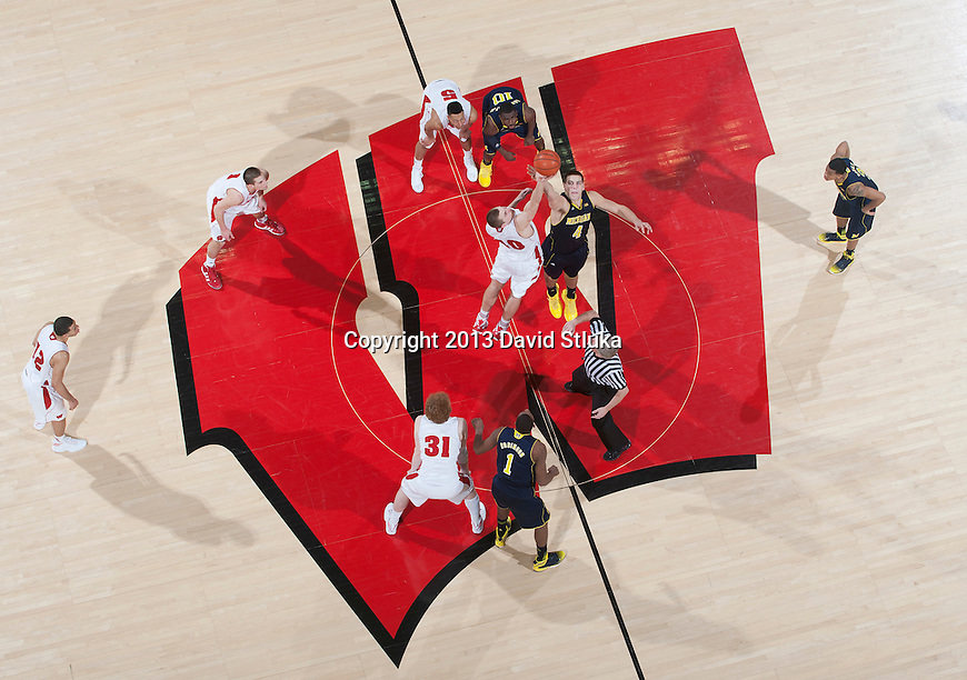 An overhead view of the floor overtime tipoff of the Wisconsin Badgers Big Ten Conference NCAA college basketball game against the Michigan Wolverines Saturday, February 9, 2013, in Madison, Wis. The Badgers won 65-62 (OT) (Photo by David Stluka)