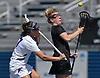 Alyssa Parrella #7 of Hofstra University, left, and Natalie Sulmonte #11 of Towson battle for control of a faceoff during a CAA women's lacrosse game at Shuart Stadium in Hempstead, NY on Sunday, April 16, 2017. Hofstra won by a score of 17-15.
