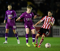 Lincoln City's Tom Pett vies for possession with Carlisle United's Liam McCarron<br /> <br /> Photographer Chris Vaughan/CameraSport<br /> <br /> The Emirates FA Cup Second Round - Lincoln City v Carlisle United - Saturday 1st December 2018 - Sincil Bank - Lincoln<br />  <br /> World Copyright © 2018 CameraSport. All rights reserved. 43 Linden Ave. Countesthorpe. Leicester. England. LE8 5PG - Tel: +44 (0) 116 277 4147 - admin@camerasport.com - www.camerasport.com
