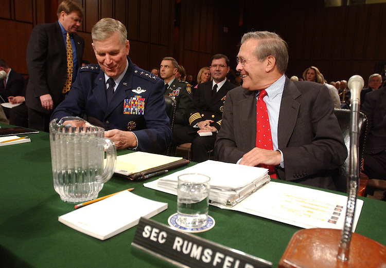 rumsfeld2/020502 - Defense Secretary Donald Rumsfeld chats with Gen. Richard Myers, chairman, Joint Chiefs of Staff, before a full committee hearing on proposed legislation authorizing funds for FY2003 for the Defense Department, and the Future Years Defense Program.