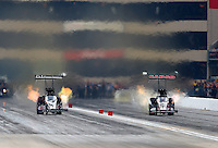 Jul 11, 2015; Joliet, IL, USA; NHRA top fuel driver Steve Torrence (right) races alongside Dave Connolly during qualifying for the Route 66 Nationals at Route 66 Raceway. Mandatory Credit: Mark J. Rebilas-USA TODAY Sports