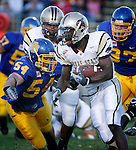 Karrington Bush #23 of Texas State tries to run around South Dakota State tackler Danny Batten #54 in the first half of their game Saturday evening at Coughlin-Alumni Stadium in Brookings, S.D. (Photo by Dick Carlson/Inertia
