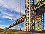 The George Washington Bridge looms large over the Little Red Lighthouse