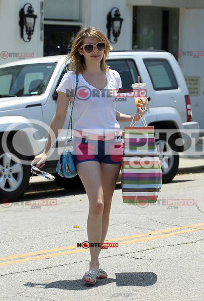 Emma Roberts wore a colorblocking pair of short shorts with a sheer white tee, nude rimmed shades and encrusted sandals while shopping at Coach in Los Angeles, California on 3.7.2012..Credit: Correa/face to face.. / Mediapunchinc