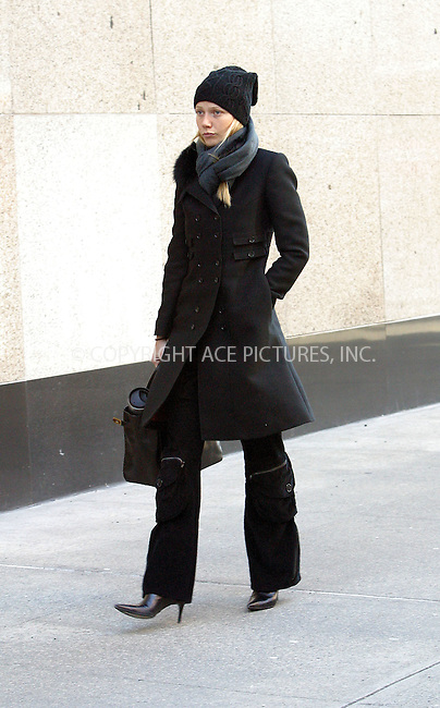 ***EXCLUSIVE***..Actress Gwyneth Paltrow battles bitter cold weather as she strolls down East 79 Street. Gwyneth has been spotted visiting Michelle Rosenfeld Art Gallerty on upper East Side. Dressed in black, Gwyneth, nevertheless, makes a fashion statement as her outfit features lots of buttons, pockets and zippers. New York, February 25, 2003..Please byline: Alecsey Boldeskul/NY Photo Press.   ..*PAY-PER-USE*      ....NY Photo Press:  ..phone (646) 267-6913;   ..e-mail: info@nyphotopress.com