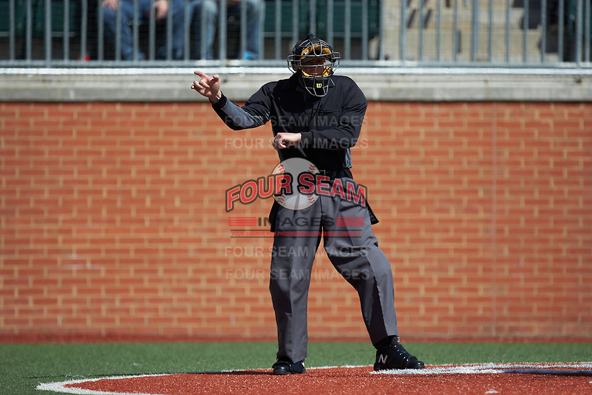 Home plate umpire Richie Hogg makes a strike call during the NCAA baseball game between the East Carolina Pirates and the Charlotte 49ers at Hayes Stadium on March 8, 2020 in Charlotte, North Carolina. The Pirates defeated the 49ers 4-1. (Brian Westerholt/Four Seam Images)