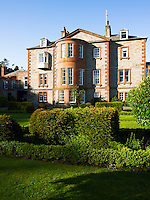 The rear facade of this 18th century country house viewed from the garden
