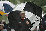 Padraig Harrington shelters while making his way off the 3rd green during the final round of the Irish Open on 20th of May 2007 at the Adare Manor Hotel & Golf Resort, Co. Limerick, Ireland. (Photo by Eoin Clarke/NEWSFILE)