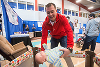 NWA Democrat-Gazette/BEN GOFF @NWABENGOFF<br /> William Yu, a soon-to-be dad from Cave Springs, competes in the 98.3 The Keg Daddy Boot Camp, a challenge to perform infant care tasks, Saturday, March 10, 2018, during the Power 105.7 Worlds Largest Baby Shower at the Jones Center in Springdale. The event sponsored by Washington Regional, with proceeds from ticket sales going to March of Dimes, included a variety of vendors, activities and seminars to help new and expecting parents provide the best care for their babies.