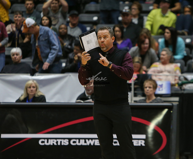 Rouse Raiders head coach Jacob Thompson talks to his team from the bench area during the Class 5A high school volleyball state final between Rouse High School and Prosper High School at Curtis Culwell Center in Garland, Texas, on November 18, 2017. Prosper won the match in five sets, (25-18, 21-25, 18-25, 25, 23, 16-14) to win the 5A state championship.