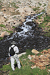 Hiker at waterfall on Mitchell Creek in Indian Peaks Wilderness Area, west of Boulder, Colorado, USA. .  John leads private photo tours throughout Colorado. Year-round Colorado photo tours.