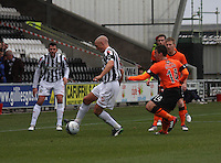 Jim Goodwin coming under pressure from Mark Millar in the St Mirren v Dundee United Clydesdale Bank Scottish Premier League match played at St Mirren Park, Paisley on 27.10.12.