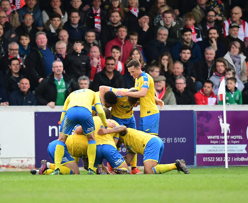 Torquay United's Ruairi Keating celebrates scoring the opening goal with team-mates<br /> <br /> Photographer Chris Vaughan/CameraSport<br /> <br /> Vanarama National League - Lincoln City v Torquay United - Friday 14th April 2016  - Sincil Bank - Lincoln<br /> <br /> World Copyright &copy; 2017 CameraSport. All rights reserved. 43 Linden Ave. Countesthorpe. Leicester. England. LE8 5PG - Tel: +44 (0) 116 277 4147 - admin@camerasport.com - www.camerasport.com