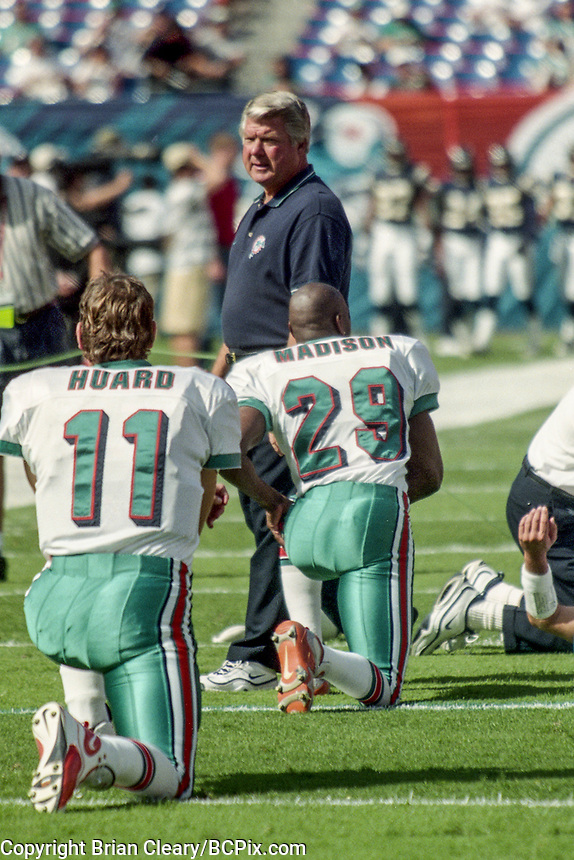 MIAMI, FL - DEC 19, 1999:  Head coach Jimmy Johnson oversees warmups before the Miami Dolphins defeat the San Diego Chargers 12-9 at Joe Robbie Stadium, in Miami, FL. (Photo by Brian Cleary/www.bcpix.com)