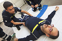 Switzerland. Canton Ticino. Pregassona. Croce Verde Lugano Headquarters. New volunteers candidates for  Croce Verde Lugano are trained on a Saturday morning during an exercise on pelvis immobilisation. They all wear blue uniforms and learn new skills for emergency rescue. The Croce Verde Lugano is a private organization which ensure health safety by addressing different emergencies services and rescue services. Volunteering is generally considered an altruistic activity where an individual provides services for no financial or social gain to benefit another person, group or organization. Volunteering is also renowned for skill development and is often intended to promote goodness or to improve human quality of life. Pregassona is a quarter of the city of Lugano.13.01.2018 © 2018 Didier Ruef
