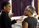 Newsday Reporter, Katie Gray, greets a friend, while covering an event of Pastor Donnie McClurkin preaching at Bible Study with his congregation at the Perfecting Faith Church in Freeport on Wednesday August 18, 2004. (Newsday Photo / Jim Peppler).