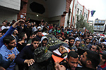 Mourners carry the body of Palestinian, who was killed in Israeli strikes during his funeral in Beit Lahia in the northern Gaza Strip on May 6, 2019. The Israeli attack on the Gaza Strip left 25 Palestinians dead and at least 154 injured, after Israel and Hamas reached a ceasefire agreement on early morning hours, mediated by Egypt. Photo by Ashraf Amra